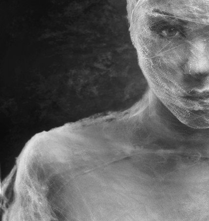 plastic wrap: Fine art portrait of a young woman wraped with cowebs Stock Photo