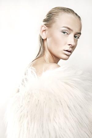 Stock Photo: Fine art portrait of a beautiful blonde in white fur Stock Photo - 8474762