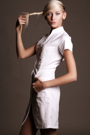 Beautiful young woman in a vogue style pose Stock Photo - 8474793