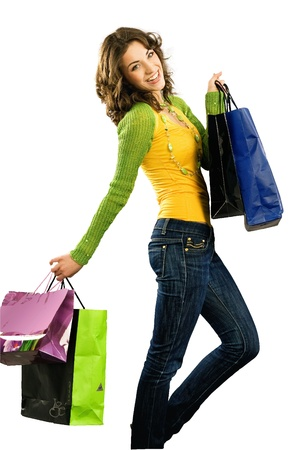 Cute happy girl with shoppingbag isolated on white  photo
