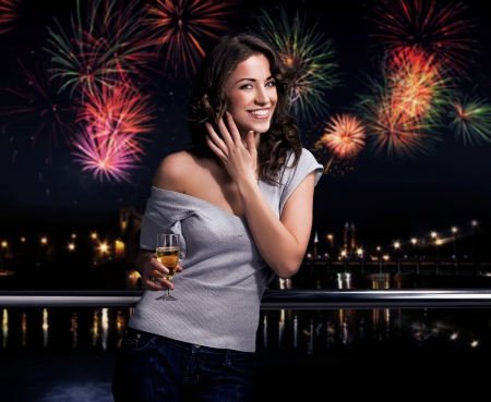Beautiful brunette on a fireworks background  photo