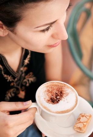Young woman enjoying coffee break  photo