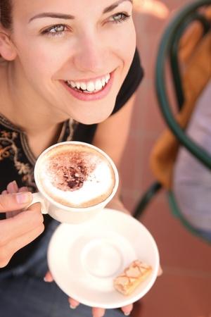 hot chocolate drink: Young woman enjoying coffee break