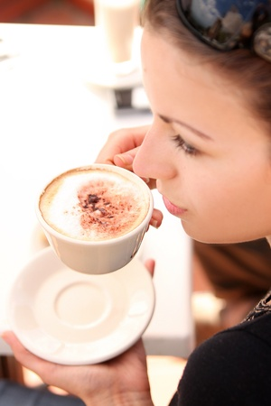 Young woman enjoying coffee break Stock Photo - 8504611
