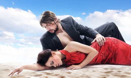 Attractive couple on the beach photo