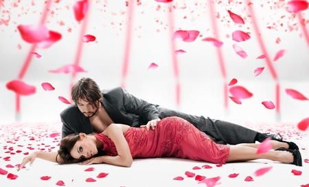 emotive: Attractive couple over falling rose petals  Stock Photo