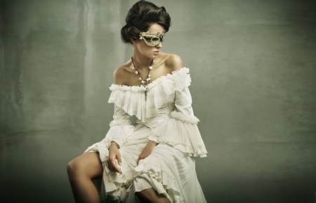 Fine art photo of a young woman wearing mask  photo