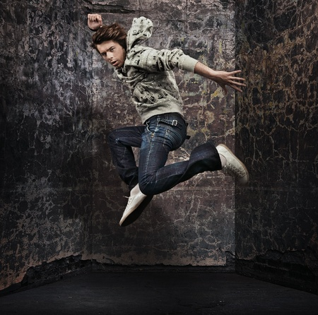 break dancer: Male dancer posing over grunge wall