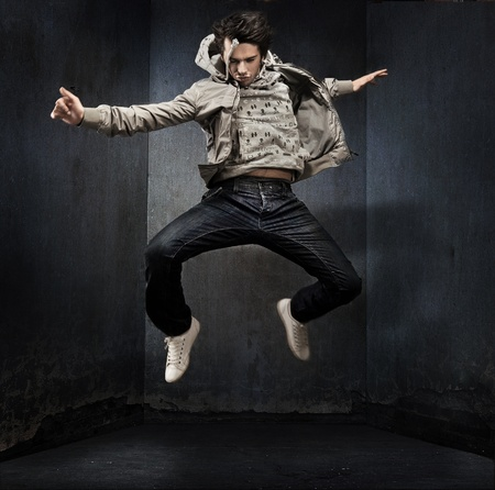 breakdancer: Male dancer posing over grunge wall