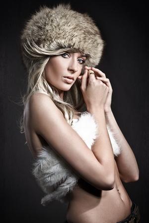 Stunning blonde beauty over dark studio background  Stock Photo - 8532221