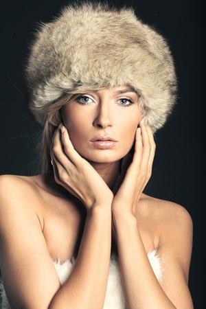 Stunning blonde beauty over dark studio background  photo