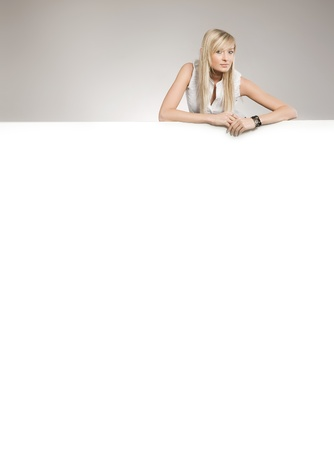 Beautiful businesswoman showing empty white board Stock Photo - 8531745