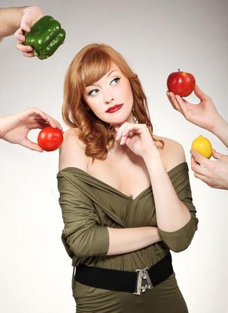 nourish: Beautiful woman making a vegetable choice