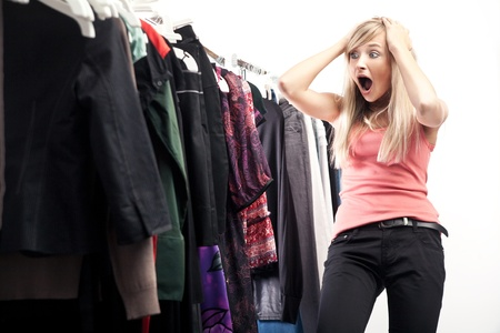 clothes closet: Young pretty blonde choosing what to put on
