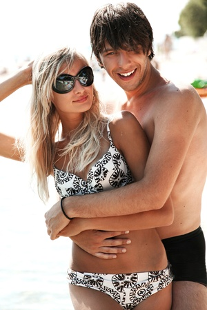 Young attractive couple on a beach  photo
