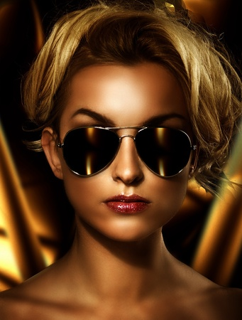 Young attractive blonde wearing stylish sunglasses  photo