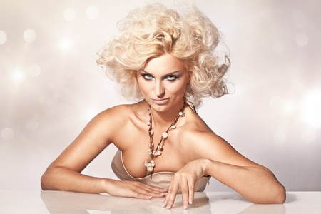 Blond beauty showing something Stock Photo - 8560003