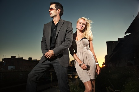Elegant couple over a sunset background  Standard-Bild