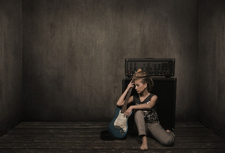 Girl with guitar in a vintage room  photo
