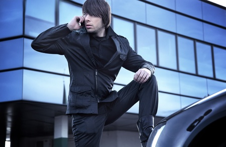 Handsome guy talking over cellphone Stock Photo - 8738770
