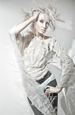 Vogue style of a blond beauty Stock Photo - 8738893