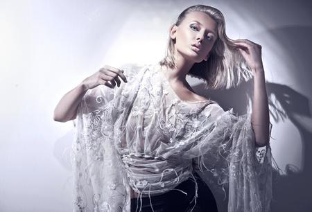 Vogue style of a blond beauty Stock Photo - 8738915