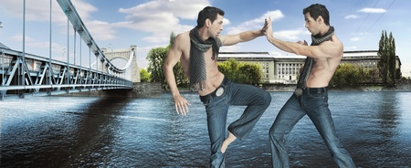 Two karate fighters kicking on the riverside photo