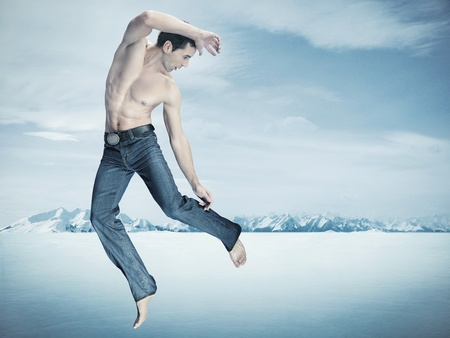 Taekwondo fighter training , over winter background Stock Photo
