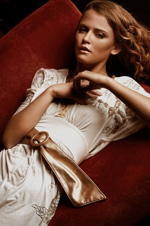 Fashion style portrait of a beautiful young lady photo