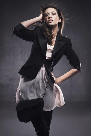 Elegant young lady posing photo
