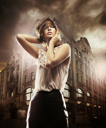 Fine art photo of a beautiful woman in front of a building photo