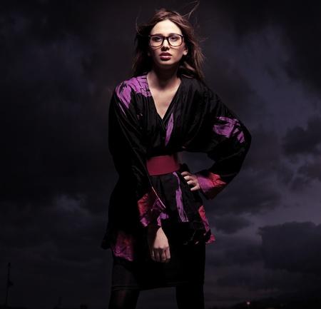 Studio photo of an elegant brunette posing Standard-Bild