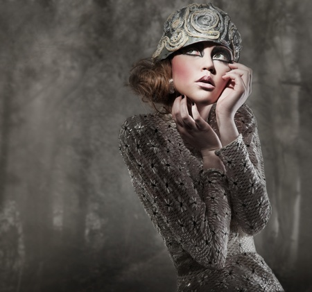 beautiful young lady in a mysterious gray forest photo