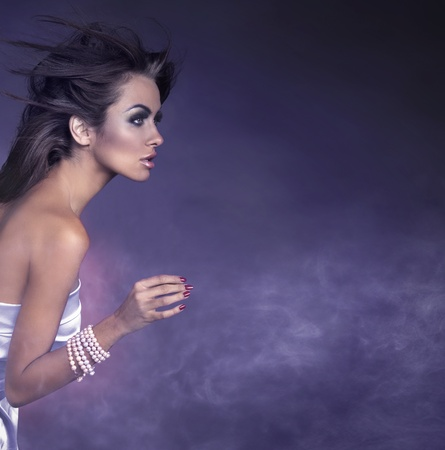 Profile portrait of a young brunette beauty Stock Photo - 8877826
