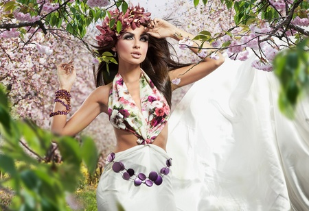 Stunning brunette beauty in a cherry orchard Stock Photo