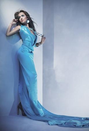 Stunning female beauty wearing blue dress photo