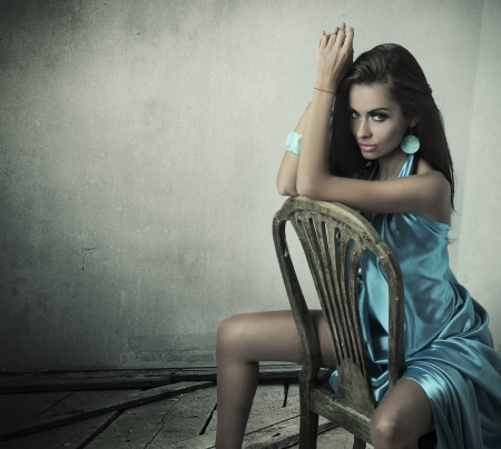 Stunning female beauty wearing blue dress photo