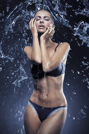 Stunning brunette taking a shower photo