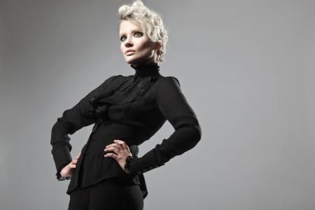 Lady in black posing Stock Photo