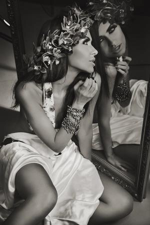 Brunette beauty in a mirror photo