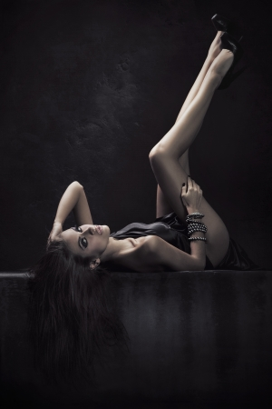 Brunette beauty in a dark chamber Stock Photo - 8942150