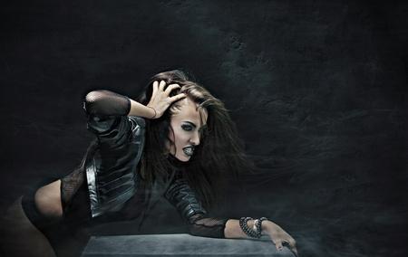 Evil rock-star woman photo