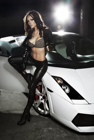 Sexy lady in front of a sport car photo