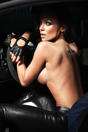 Sexy woman sitting in a sport car photo
