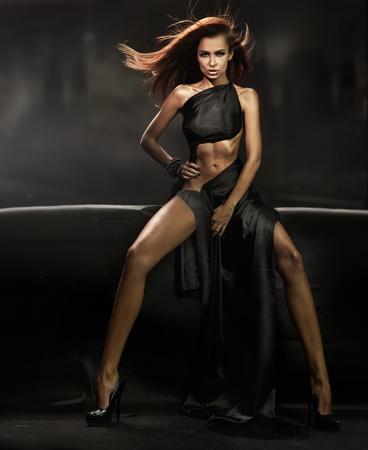 Beautiful brunette over dark background Stock Photo - 8942581