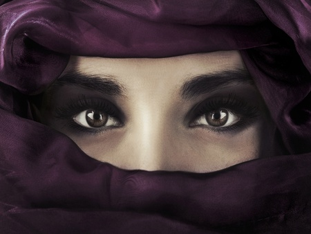 A young middle eastern woman wearing a purple head covering photo