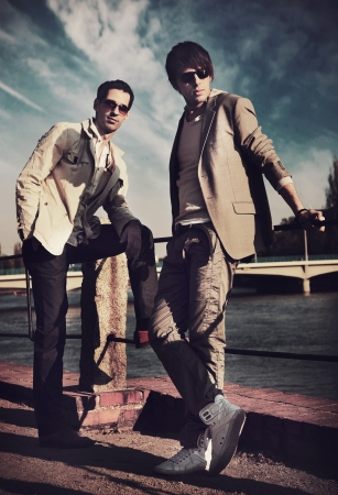 shoes fashion: Two handsome friends posing on a city promenade Stock Photo