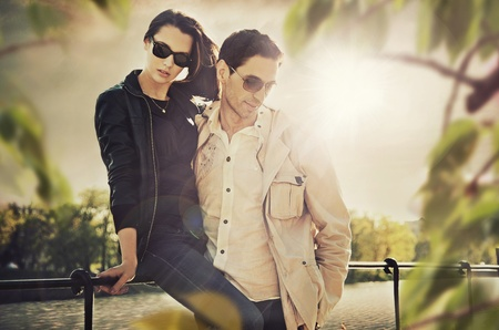 Attractive young couple wearing sunglasses photo