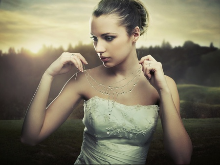 Fine art photo - young lady wearing a necklace of morning dew photo