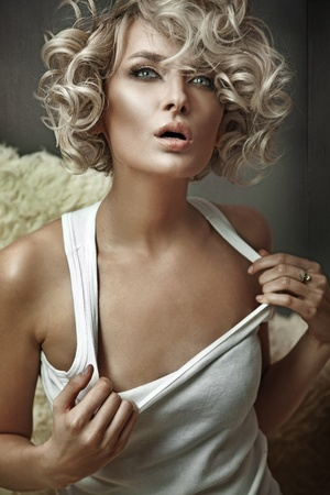 Vogue style photo of a young blond beauty photo